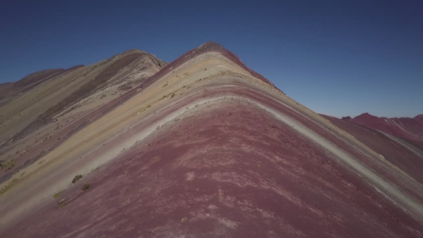 Drone flies over colored mountain in Peru