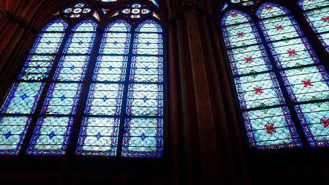 Stained glass windows inside the Notre Dame Cathedral, UNESCO World Heritage Site. Paris, France