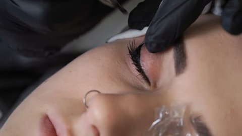 Beautician, specialist of permanent make-up making eyeliner permanent make up