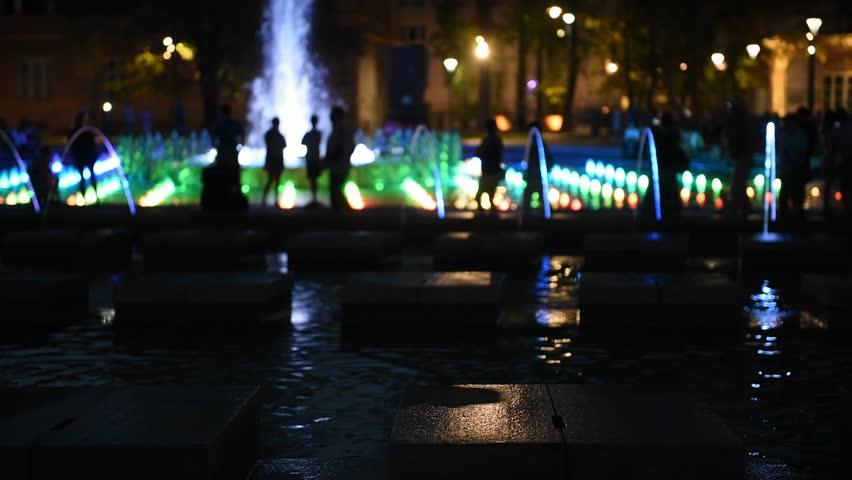 Illuminated street fountain in city a square | Shutterstock HD Video #33799396