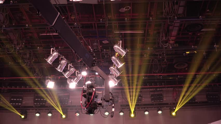 Digital broadcasting studio, camera JIB crane, lighting, mixer and equipment in studio. | Shutterstock HD Video #33855226