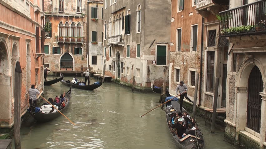 VENICE, ITALY - MAY 11: Gondolas in one of the canals in Venice on May 11, 2012. Gondolas are now mainly used for touristic purposes but where once the main form of transportation in Venice.