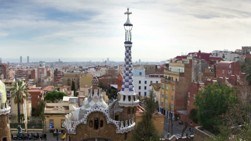 BARCELONA - JANUARY 07: A timelapse shot in Parc Guell, one of the city's major tourist attractions, with the urban skyline in the background, Barcelona, Spain. JANUARY 07, 2013.  | Shutterstock HD Video #3389006