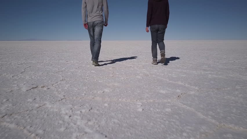 People walking on Salar de Uyuni salt flats