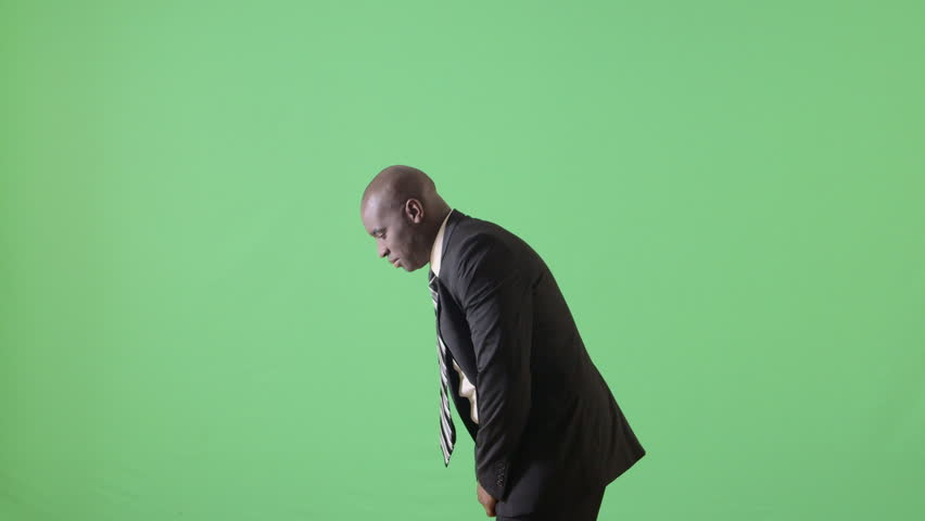 Side view of African American businessman holding arms out wide and looking upward | Shutterstock HD Video #3389657