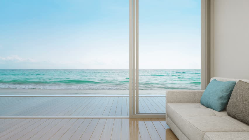 Sofa on wooden floor near glass door with ocean and sky background at luxury apartment, Lounge in sea view living room of modern beach house or hotel - Summer home interior 3d illustration
