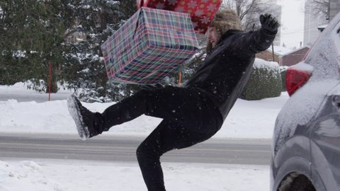 Man slipping on ice with presents