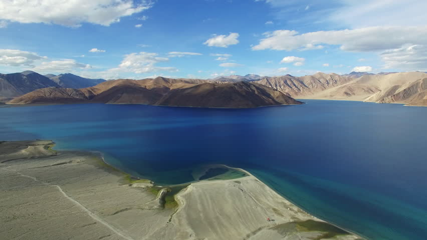Aerial View. Himalayan lake. Flying over the beautiful lake near mountains. Aerial camera shot. Landscape panorama. Himalaya. Pangong Lake, Leh Ladakh, 4600m high from the ground.
