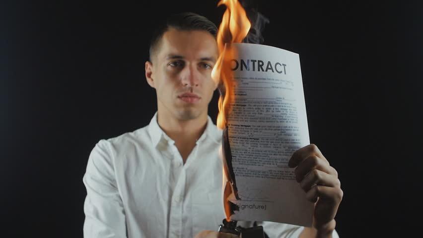 Businessman burns a contract document. Destruction of securities. Interruption of an agreement | Shutterstock HD Video #34139746