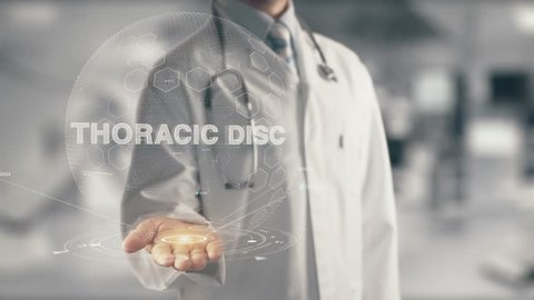 Doctor holding in hand Thoracic Disc
