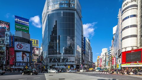 TOKYO, JAPAN - DECEMBER 29: People and cars cross the famous intersection in Shibuya, Tokyo in time lapse on December 29, 2012. It is one of the most heavily used diagonal crossings in the world.