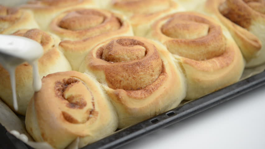 Swedish cinnamon rolls under sweet sauce