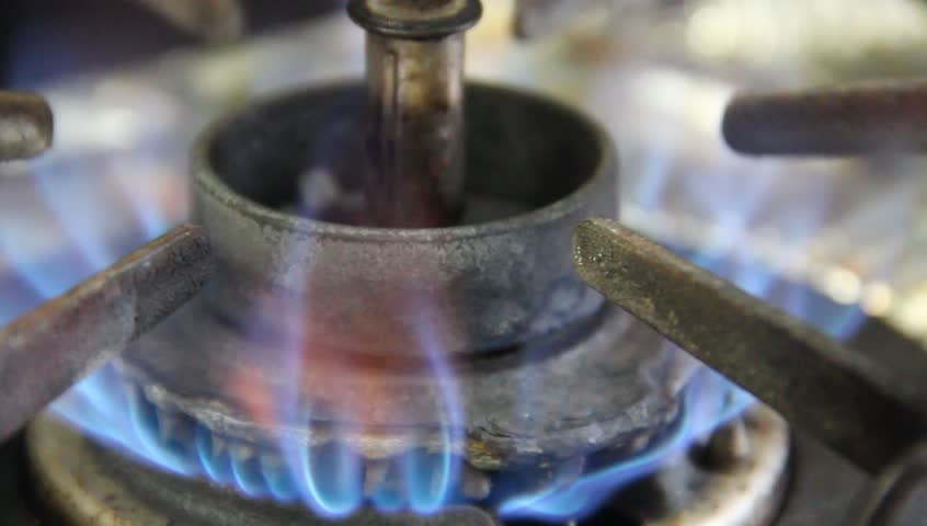 Blue flames of gas burning from a kitchen