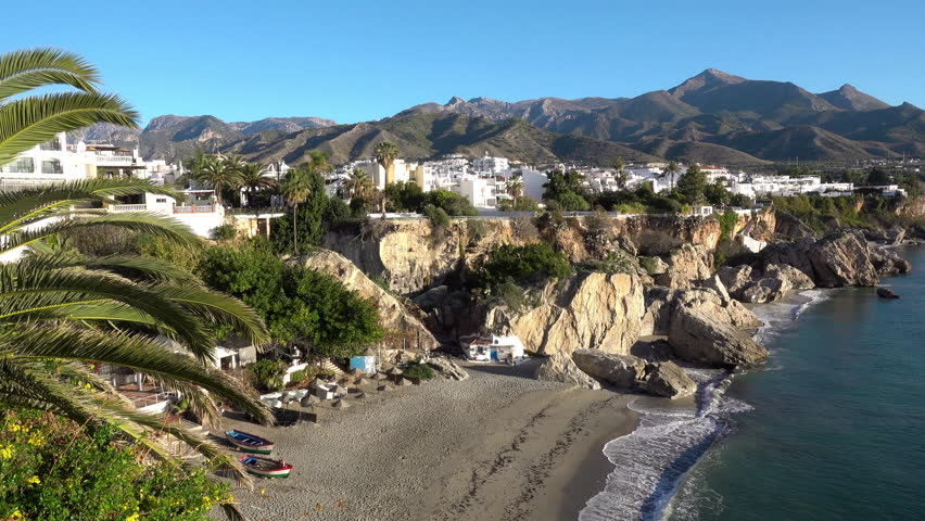 The spanish town Nerja, on the Costa del Sol coast (with Playa Catahonda and the Sierra mountains visible)