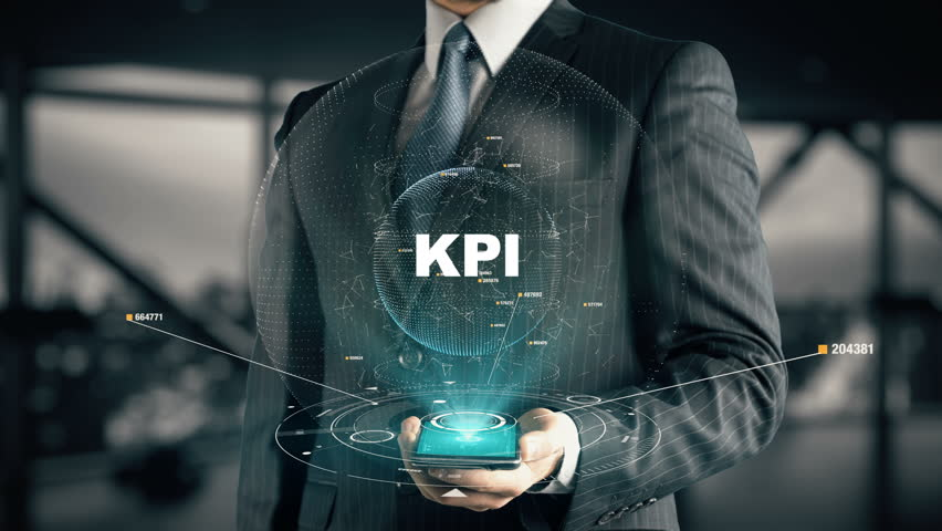 Businessman with KPI hologram concept