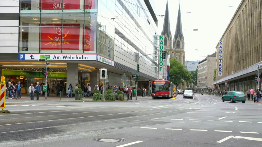 Dusseldorf, Germany - August 4,2017: Crossroads of  streets of Schadow Strasse, Jacobi Strasse, Wehrhahn Strasse and Tonhallen Strasse in  city center with St. Maria Empfaengnis church on background