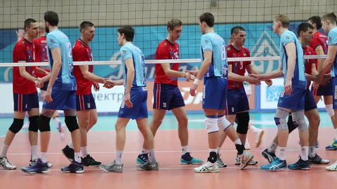 MOSCOW - APR 8, 2017: (slow motion) Teams greet before volleyball game Dynamo (Moscow) and Nova (Novokuibyshevsk) in Palace of Sports Dynamo