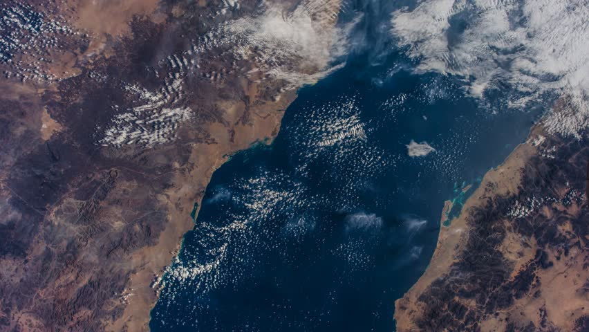Time lapse parts of earth at daytime viewed from International Space Station ISS-Atlantic ocean to Nile river, Egypt, Red sea and Arabian peninsula. Elements of this video furnished by NASA.