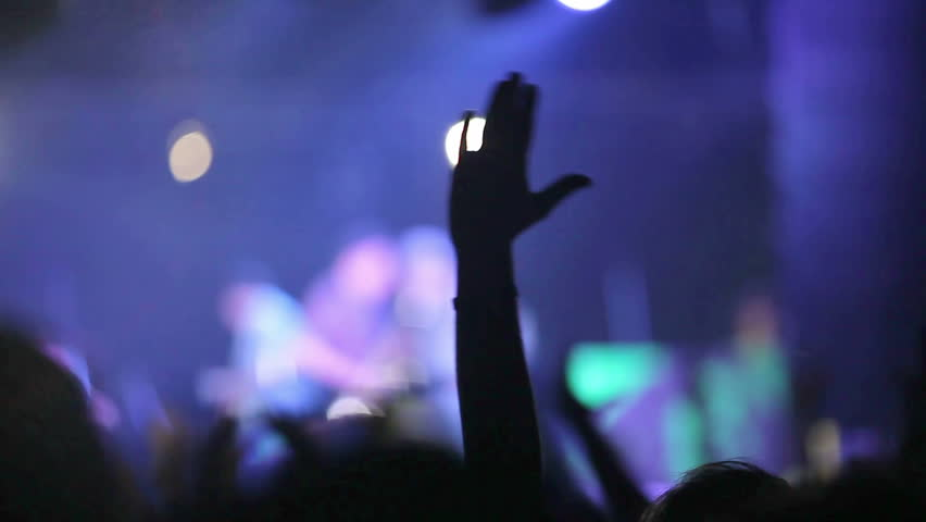 Crowd partying at a rock concert. Hands up