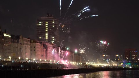 New Years Eve in Dusseldorf Germany Public Celebrations with panoramic view of city filmed from the River Rhine