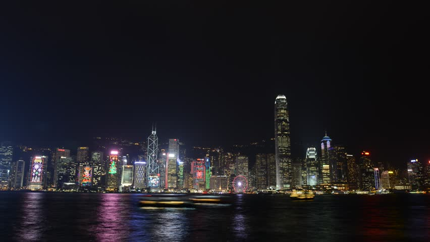 Timelapse HD video of Hong Kong harbour at night with city skyline of crowded buildings | Shutterstock HD Video #34457326