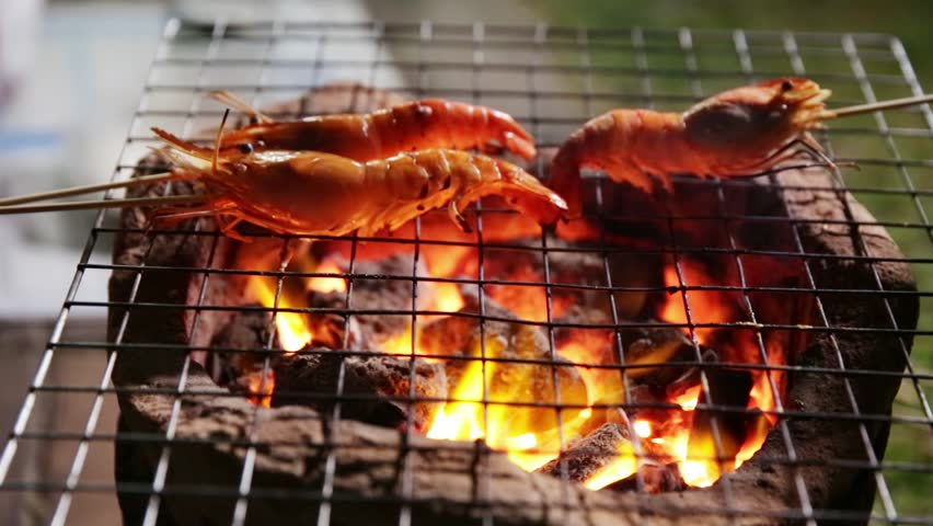 Prawns grilled on charcoal stove | Shutterstock HD Video #34486066