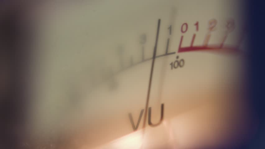 Analog measuring device with the needle in motion, studio closeup - vu / level audio meter. Volume Unit (VU)