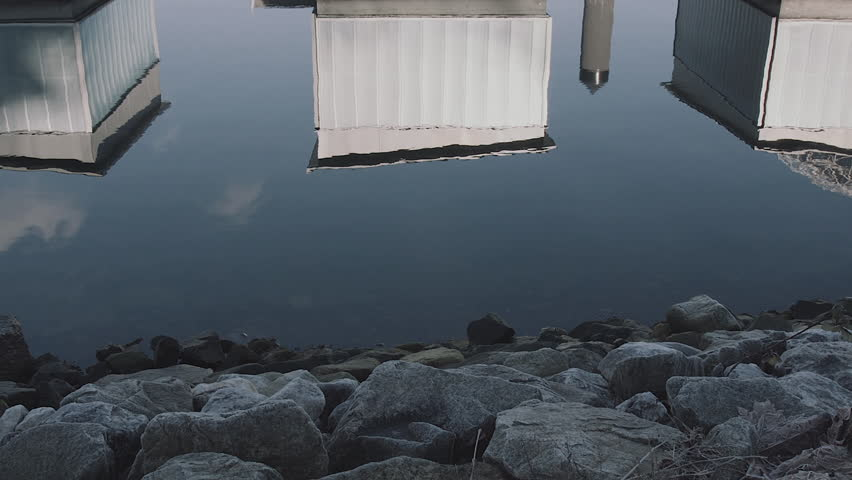 C100 MK II footage of boathouse reflections and rocky shoreline in False Creek, Vancouver.