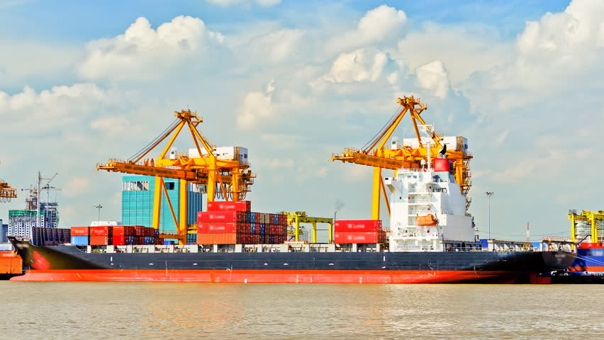 Container Cargo freight ship with working crane bridge in shipyard for Logistic Import Export background