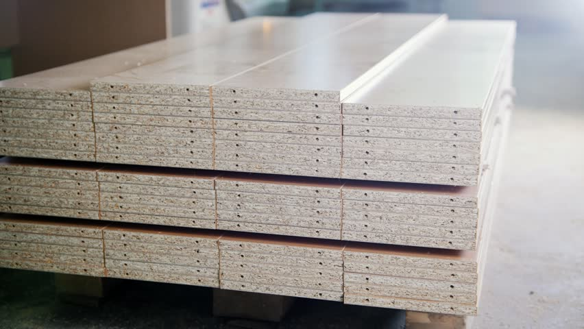Stack of wood particleboard panels on the warehouse or factory | Shutterstock HD Video #34559806