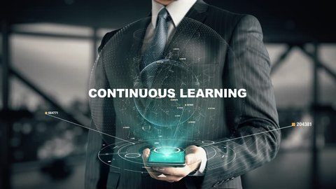 Businessman with Continuous Learning hologram concept