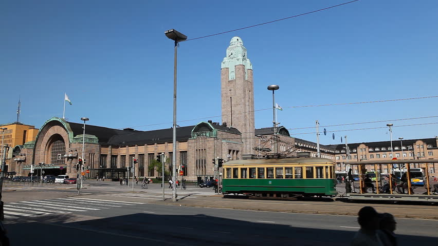 HELSINKI, FINLAND - MAY, 10, 2011 Old Tram in front of Helsinki Central Railway Station, Finland, VR Commuter Rail Network