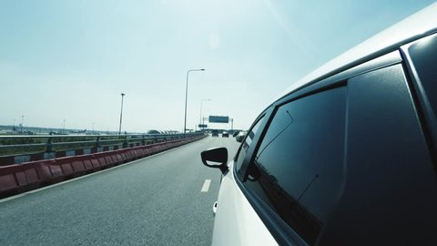 4K - Shot of car moving through airport road to the Suvarnabhumi airport terminal entrance. Camera placed on upper left side of the vehicle and faces forward. (POV #11)