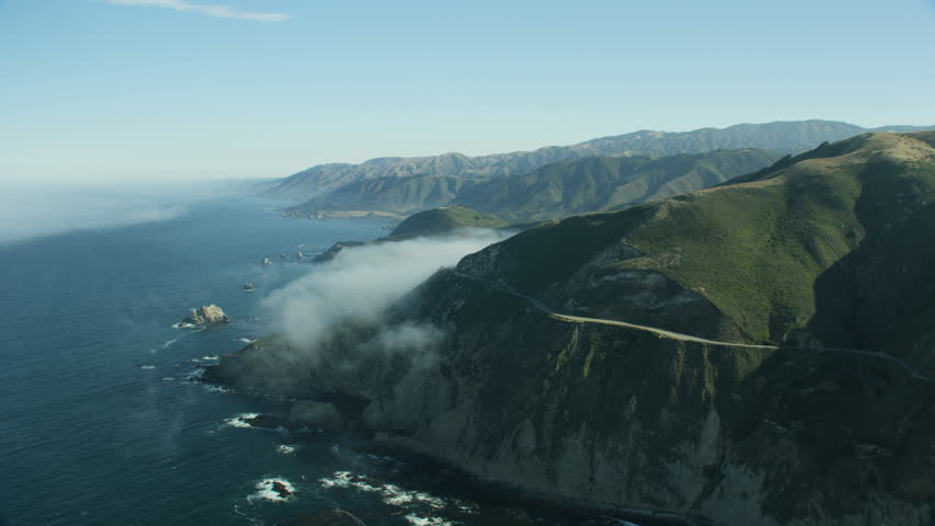 Aerial view mountain ranges Big Sur rugged coastline with coastal sea fog Highway 1 coast road California USA RED WEAPON