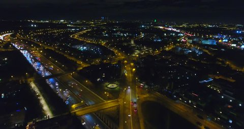 Aerial night illuminated highway of rolling Madrid city and districts - 001