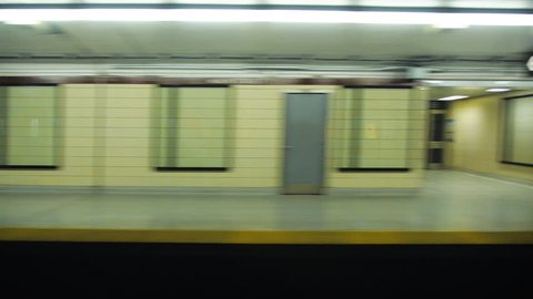 Toronto subway slowing down and stopping in station