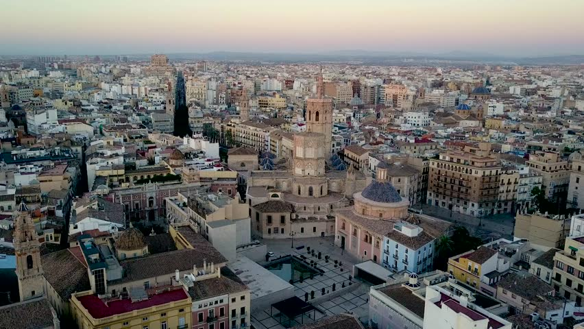 Valencia Spain aerial footage slowly tracking forward over the city. Featuring La Catedral and Miguelet Bell Tower