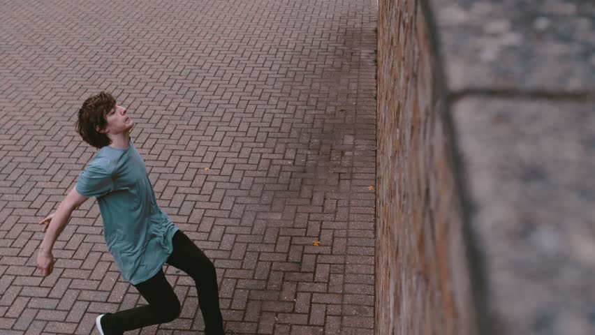 Super slow motion free running acrobat in street shot on Phantom Flex 4K #34693336