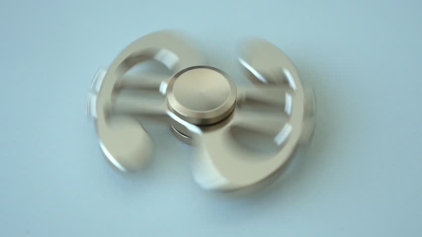 Slow spinning spinner toy in the form of a dollar closeup | Shutterstock HD Video #34748776