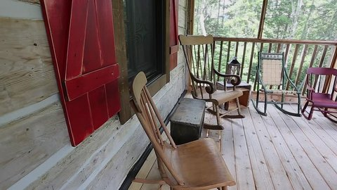 rocking chairs on the deck paning view at cottage