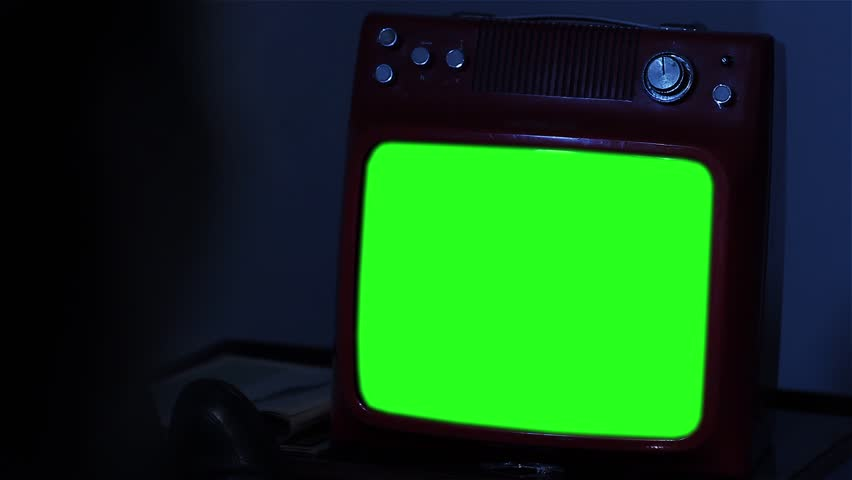 "Person Watching Retro Television Green Screen Late at Night at Home. You can replace green screen with the footage or picture you want. You can do it with ""Keying"" effect in After Effects. 