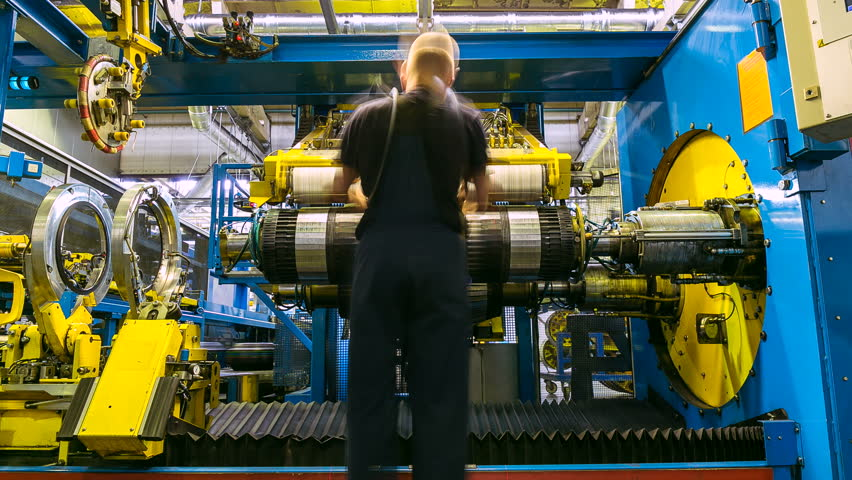 time lapse backside view worker in yellow helmet operates modern automatic rotating tire machine tool