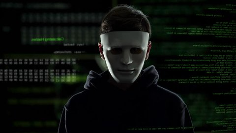 Anonymous scary hacker taking off mask, IT criminal disclosure, confession