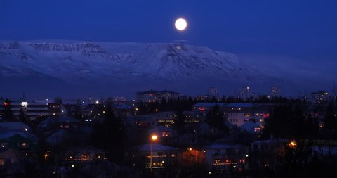 Cozy Reykjavik Iceland Christmas winter night, geese flock under full moon