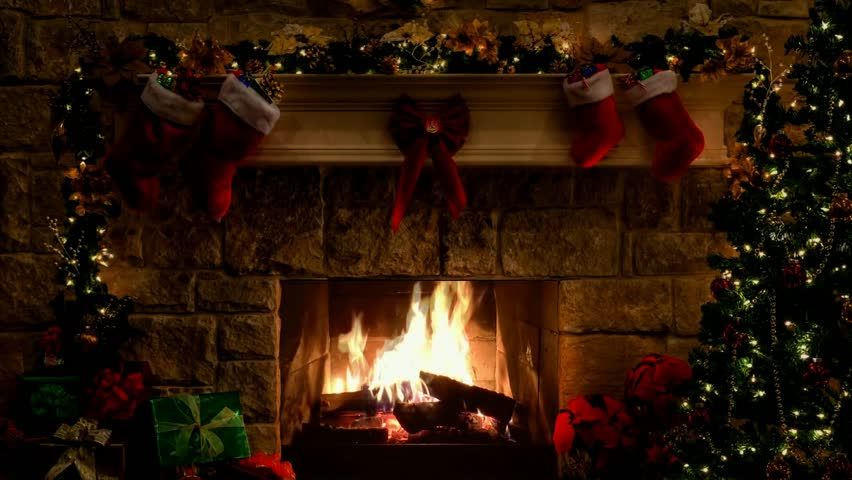 Splendid, impressive fireplace with relaxing fire in the fully decorated Christmas room