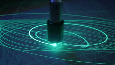 Big pendulum draws ellipses with light on phosphorus surface. Science, physics and experiment concept
