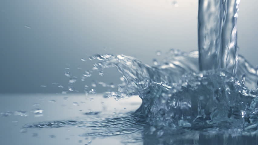 Close up of splash of water. Slow motion.