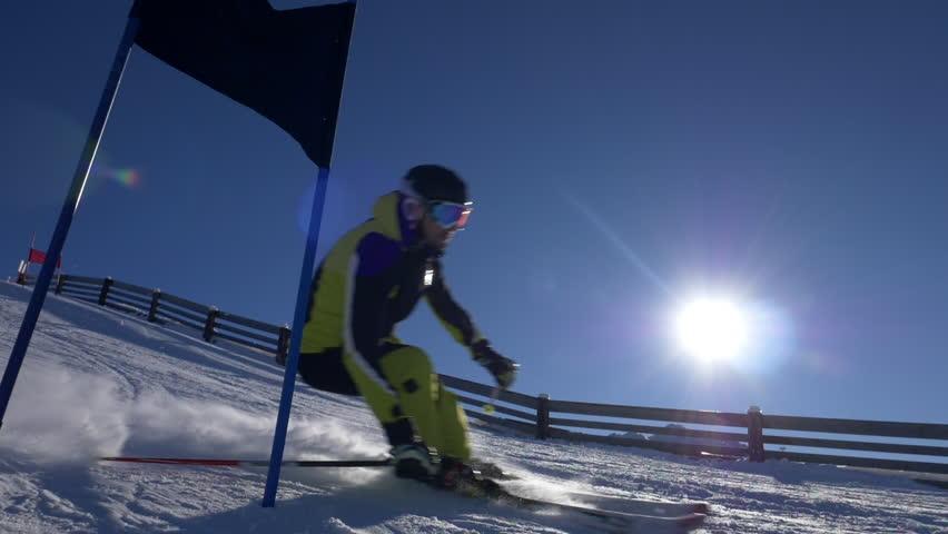Slow motion - Slalom skier skiing past the gate