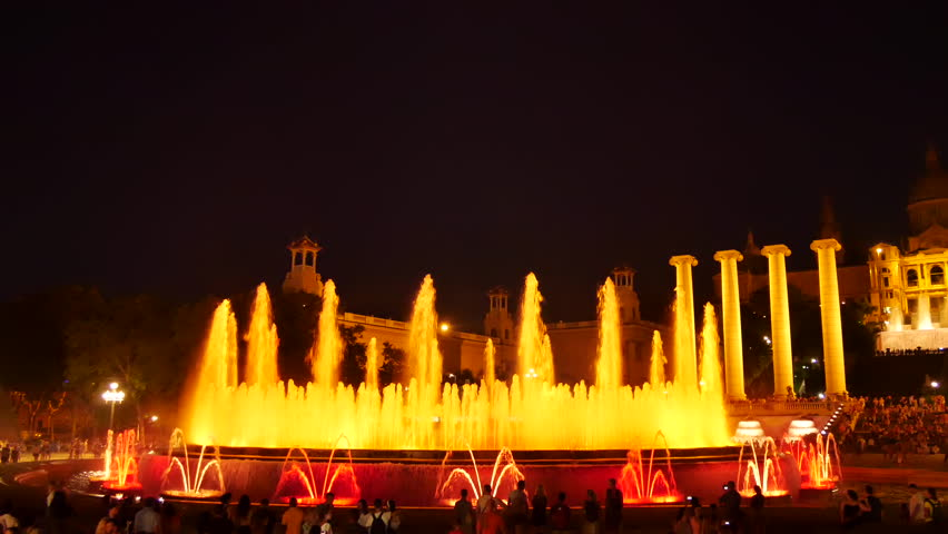 Barcelona Magic fountains attraction, a lot of tourists looking at colorful night show with different water shapes at late evening. Montjuic fontaine, Font magica de Montjuc.   Shutterstock HD Video #34910296