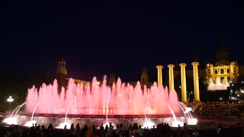 Barcelona Magic fountains attraction, a lot of tourists looking at colorful night show with different water shapes at late evening. Montjuic fontaine, Font magica de Montjuc.   Shutterstock HD Video #34910326